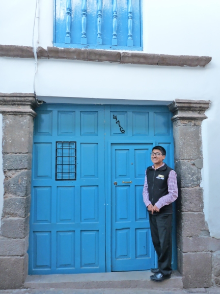 Alejandro at the door of the Niños Hotel Meloc where he works